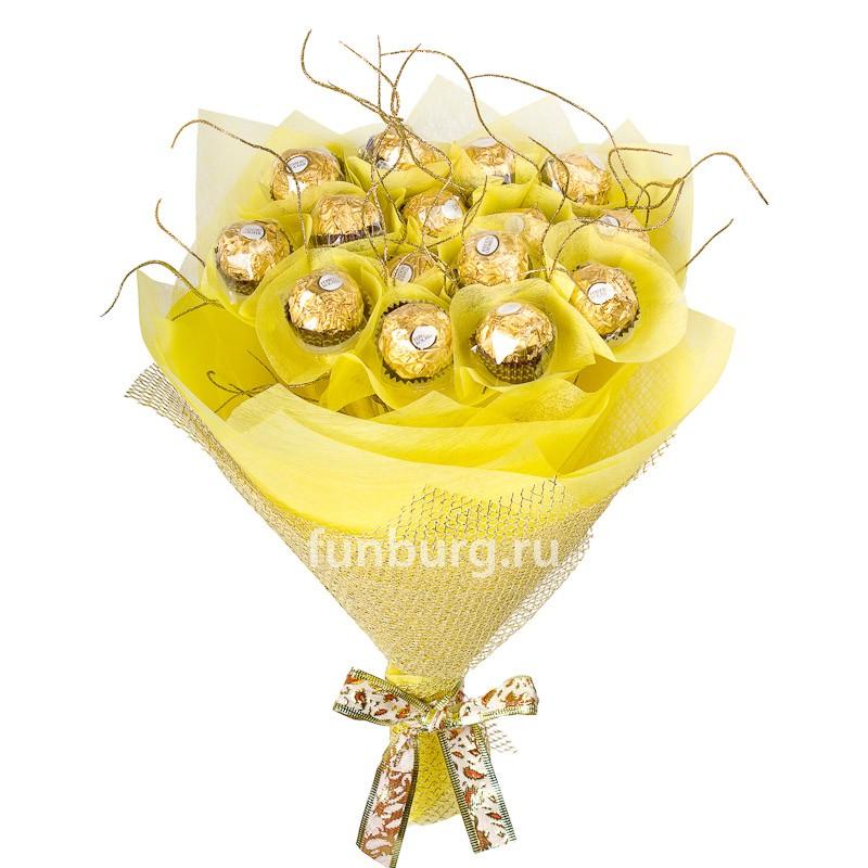 Букет из конфет «Золото Ферреро»Букеты из конфет<br><br> Состав:<br><br><br> 15&amp;nbsp;конфет «Fererro Rocher», декоративный материал, фетр, сетка<br><br><br> Размер:<br><br><br> диаметр 25-30 см, высота 35 см<br><br><br>